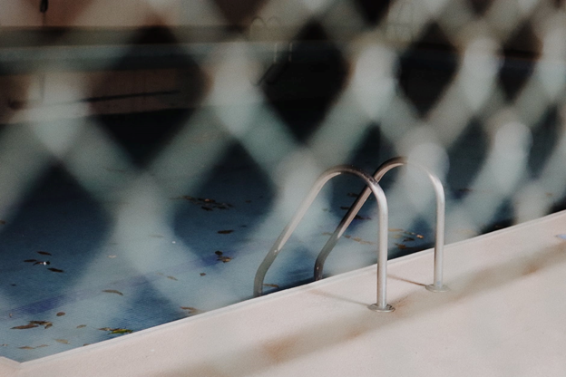 A Blurred Image of a Pool Fence