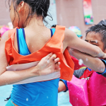Children having fun near the swimming pool