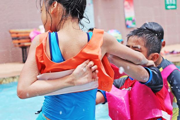 Children having fun near the swimming pool