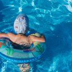 A kid enjoying in the swimming pool